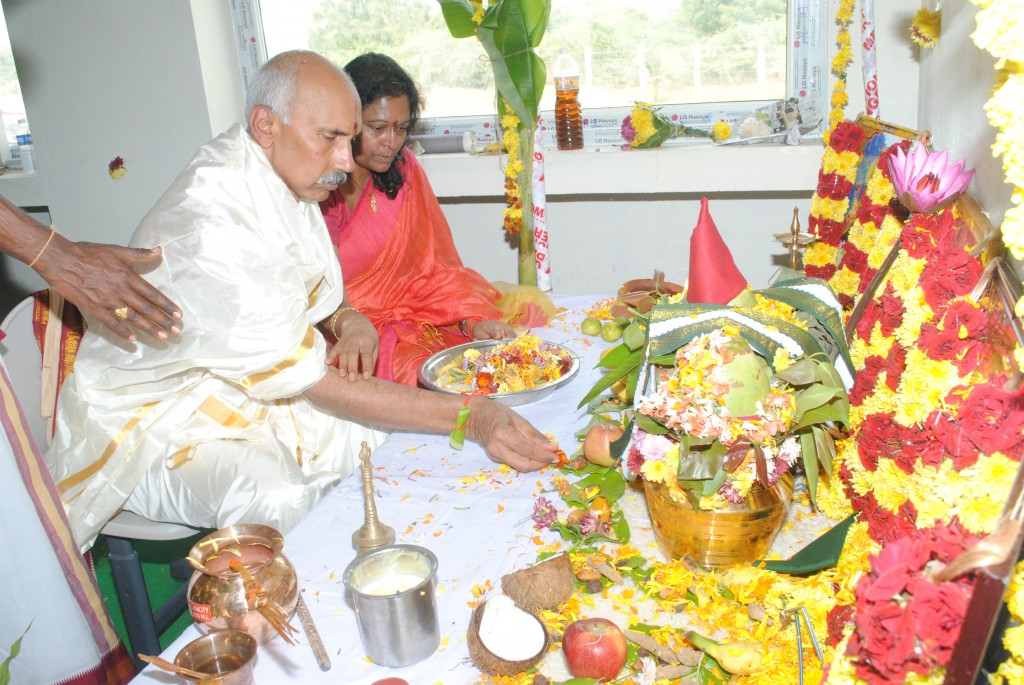 HEAL founder Dr Prasad and wife Usha at the Puja ceremony
