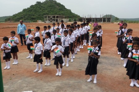 The children assemble outside the school as part of their Independence Day celebrations