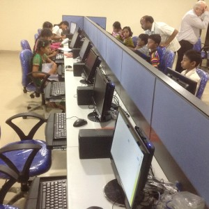 Children in computer lab at HEAL Paradise Village