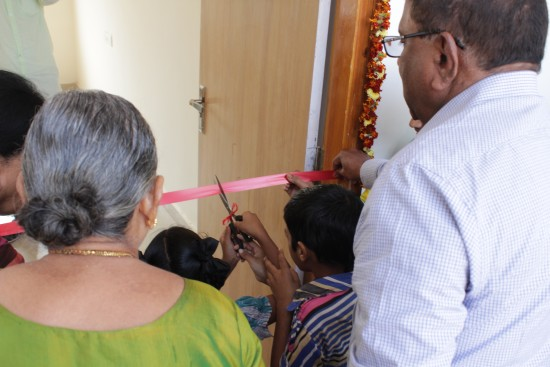 The first children to attend the Phanendra Chunduri Institute for the Visually Challenged cut the classroom ribbon, watched by Dr Dhanumjaya Rao Chunduri and family